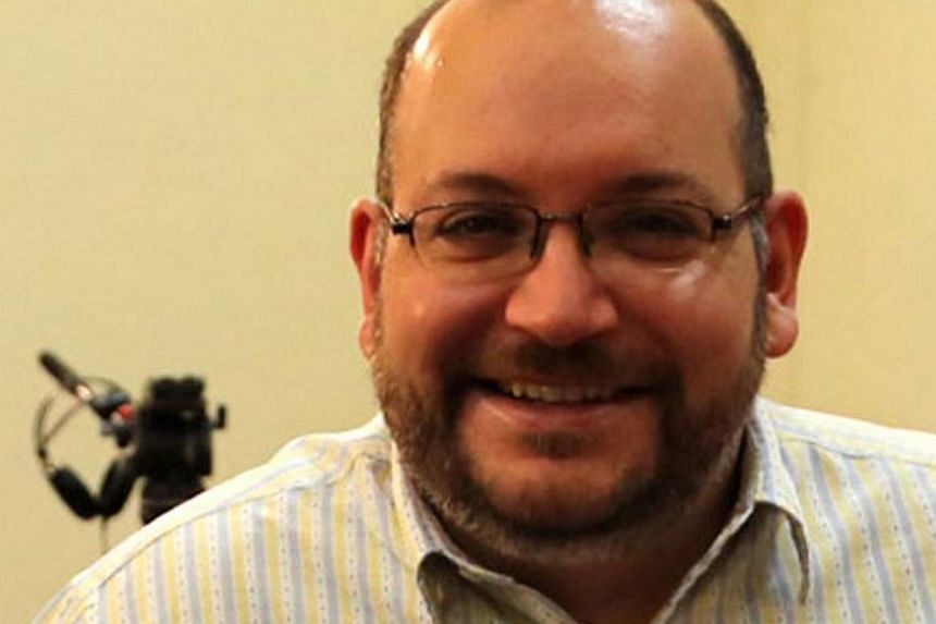 The United States called on Tuesday for the release of US citizens held in Iran - including Jason Rezaian (above) an Iranian-American with dual citizenship - but denied a report that Washington had proposed a prisoner exchange for a former US Marine.