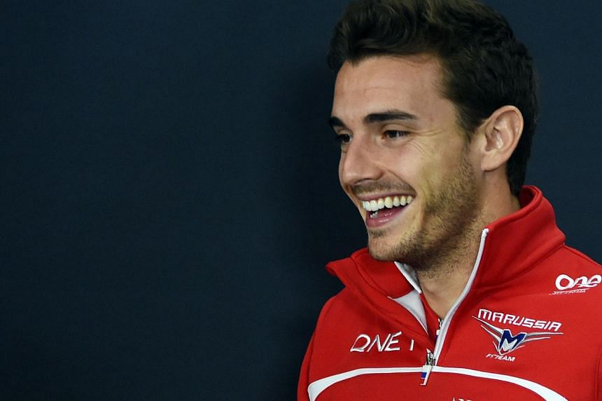 An Oct 2, 2014 picture shows Marussia driver Jules Bianchi of France smiling after a press conference for the Japanese Formula One Grand Prix, at which he was severely injured. -- PHOTO: AFP