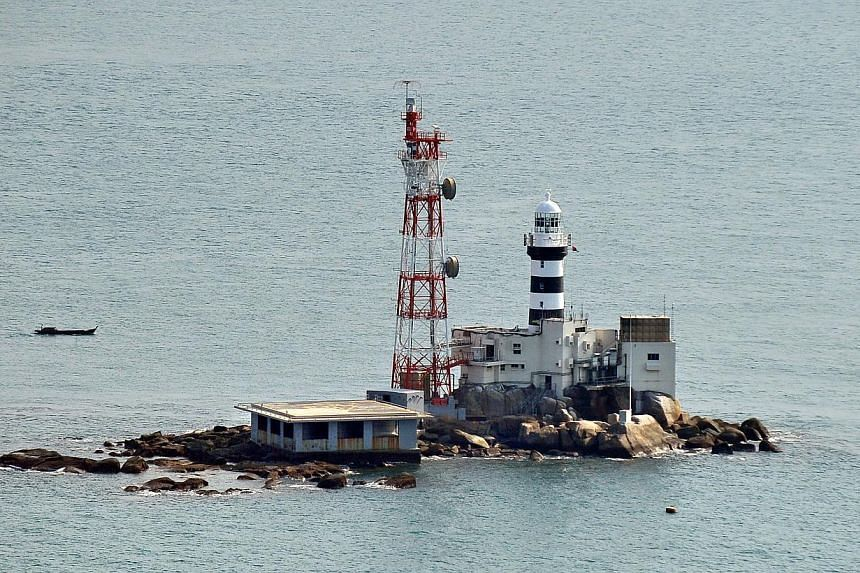 Pedra Branca in 2011. A Singapore-registered barge ran aground at Pedra Branca on Tuesday amid bad weather. -- PHOTO: ST FILE