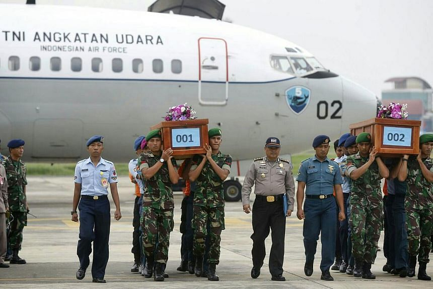 Two bodies from AirAsia flight QZ8501 arriving at Lanudal Airbase in Surabaya on Dec 31, 2014. -- ST PHOTO: KEVIN LIM