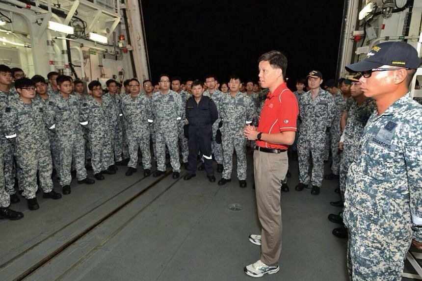 Second Minister for Defence Chan Chun Sing interacting with Republic of Singapore Navy (RSN) servicemen on board RSS Supreme on Dec 29, 2014. -- PHOTO: MINDEF