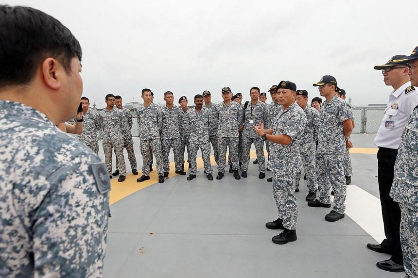 RADM Jackson Chia (Chief of Staff, Naval Staff) speaks to personnel of MV Swift Rescue before the ship departs from Changi Naval Base on the evening of Dec 30, 2014.-- ST PHOTO:SEAH KWANG PENG