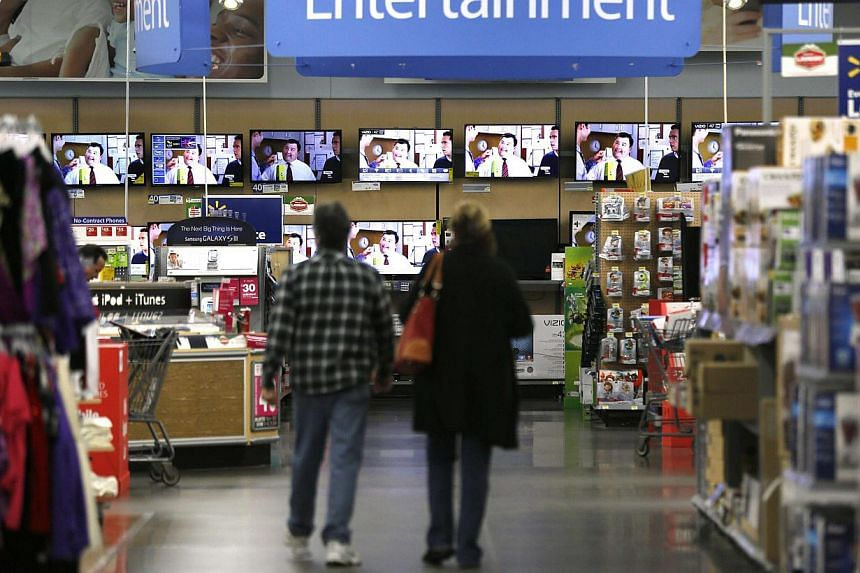 The interior of a Walmart store inBroomfield, Colorado on Nov 28, 2014.A woman was shot and killed at a Walmart store in northern Idaho on Tuesday and local media reported that the gun went off when her toddler pulled a handgun from her p