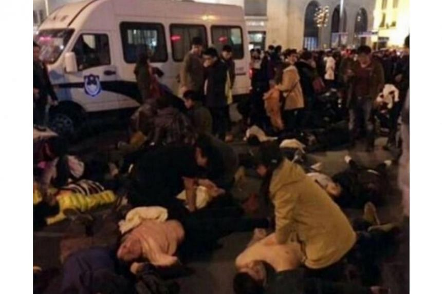 A photo on the website of the Shanghai Daily newspaper showed what appeared to be dead and injured people lying on the ground with crowds still in the background. -- PHOTO: SCREENGRAB OF SHANGHAI DAILY