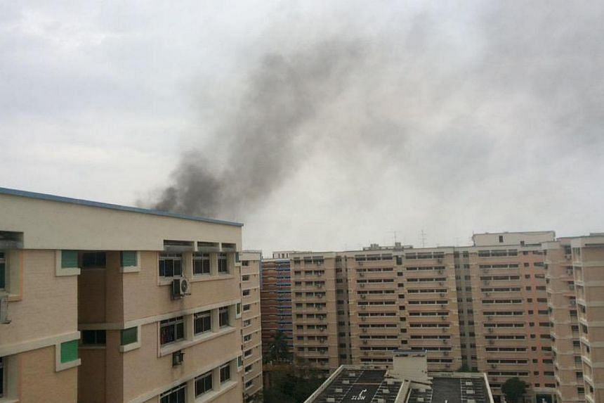 A fire broke out on Thursday afternoon at a Housing Board flat in Tampines Street 43. -- PHOTO: JOLYNN