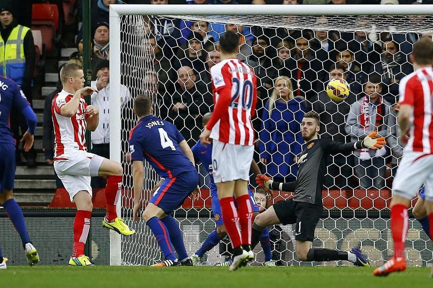 Stoke City's Ryan Shawcross (second left) shoots to score a goal during their English Premier League soccer match against Manchester United at the Britannia Stadium in Stoke-on-Trent, central England Jan 1, 2015. -- PHOTO: REUTERS