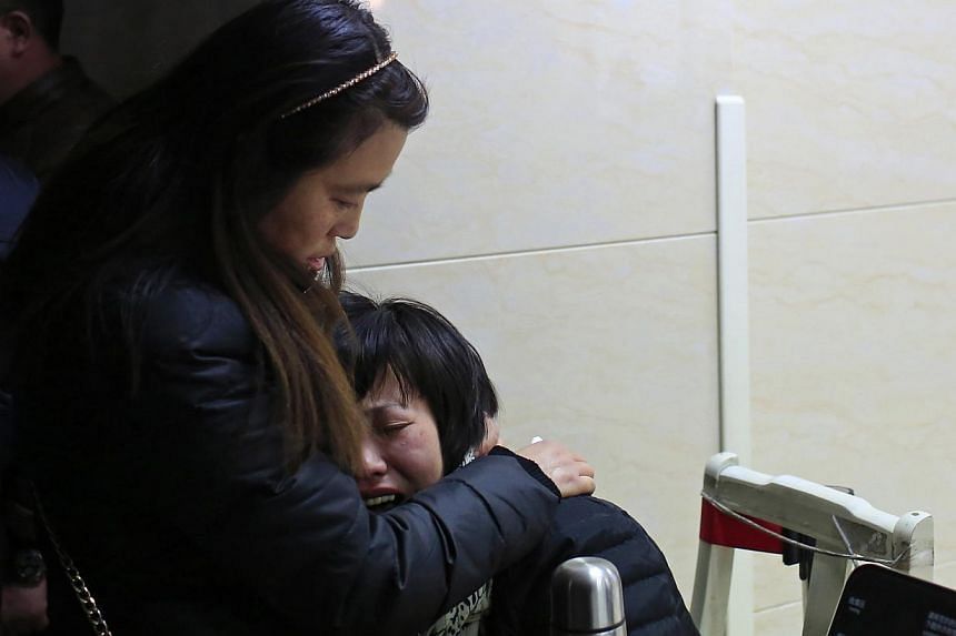 Relatives wait at a hospital where people injured in a stampede are being treated in Shanghai on Jan 1, 2015. -- PHOTO: REUTERS