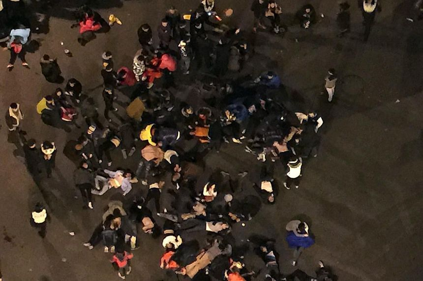 This overhead view shows people being treated at the scene after a stampede by new year's revellers in Shanghai's historic riverfront in Shanghai on Jan 1, 2015. -- PHOTO: AFP