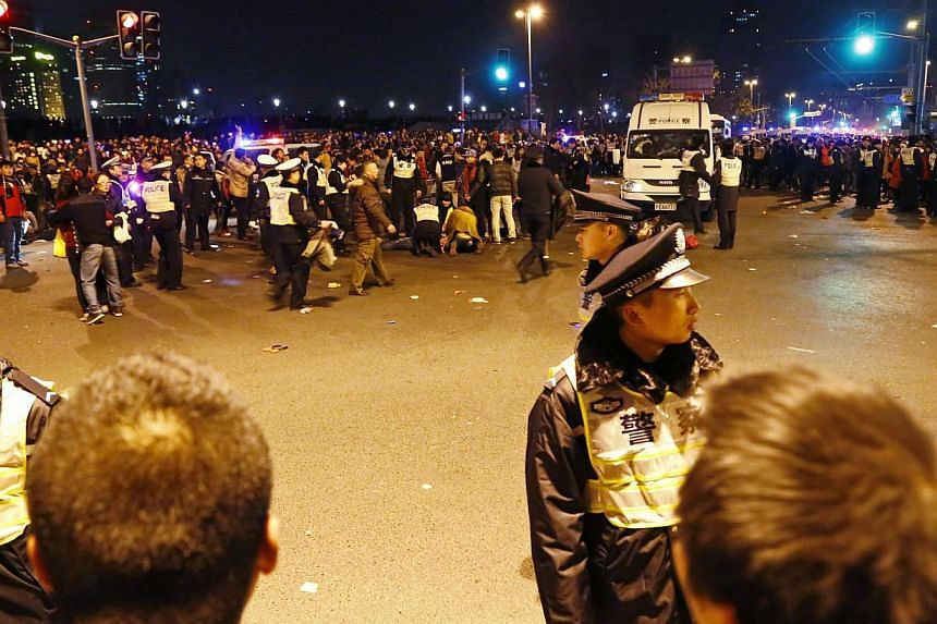 Police control the site of the stampede on Jan 1, 2015. -- PHOTO: REUTERS