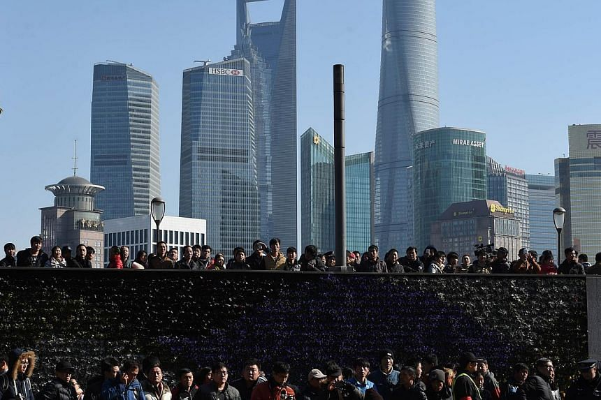 Crowds gather at the site of a New Year's Eve stampede at the Bund in Shanghai, which left at least 36 people dead, on Jan 1, 2015. -- PHOTO: AFP