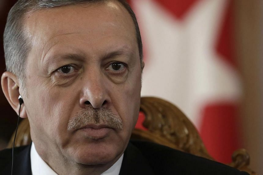 """Turkish police said Thursday that a suspected """"terrorist"""" armed with grenades and old guns was arrested after a failed attack near the office in Istanbul of President Recep Tayyip Erdogan (above).-- PHOTO: REUTERS"""