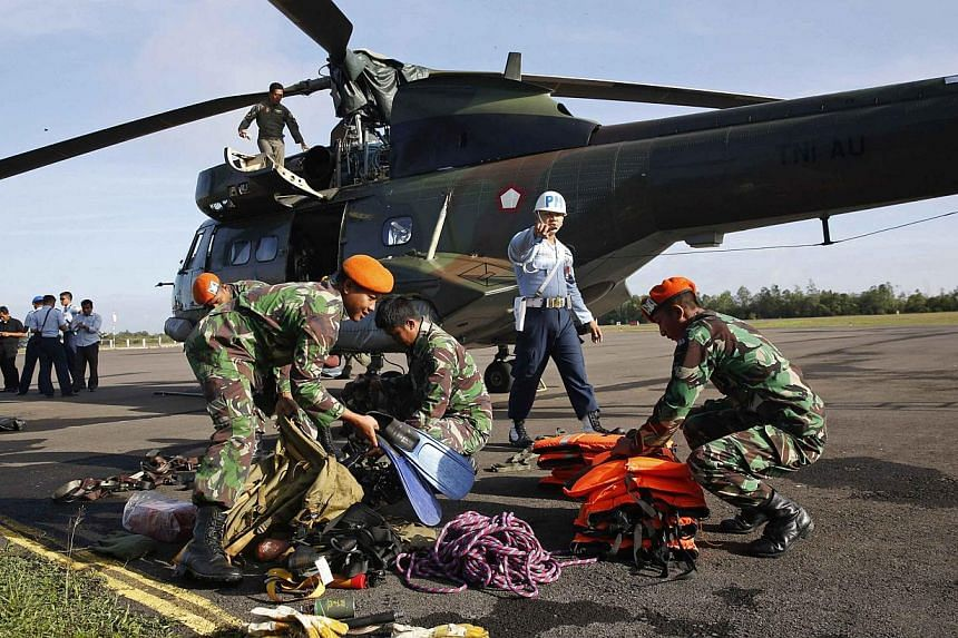 Indonesian Special Forces prepare for a recovery mission for AirAsia flight QZ8501 at the airport in Pangkalan Bun, Central Kalimantan on Jan 1, 2015. -- PHOTO: REUTERS