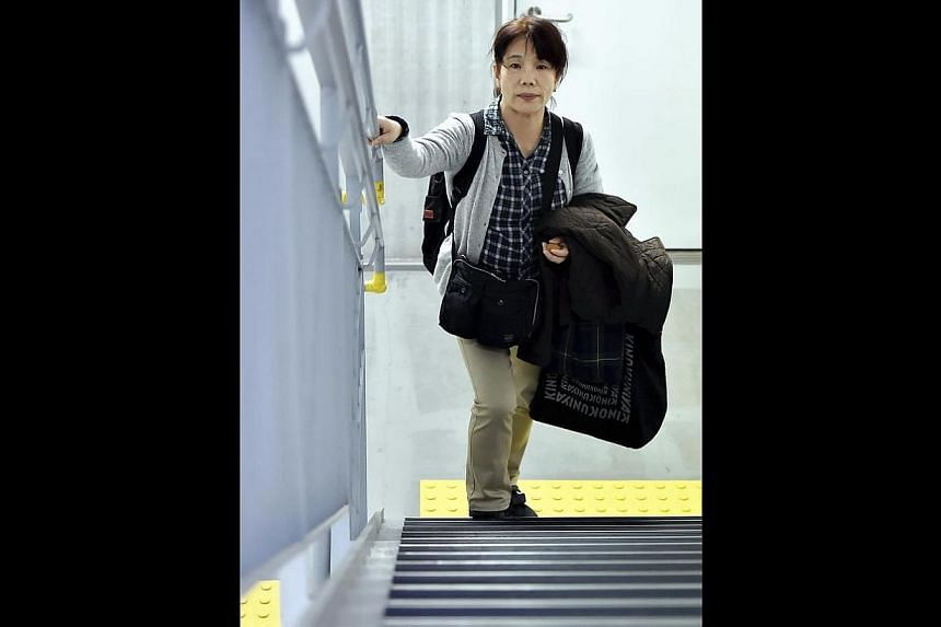 Ms Masako Ichikawa climbing the stairs in her apartment building in Minato Ward, Tokyo. With a home on the 12th floor, there are precisely 264 steps from top to bottom. A round-trip each day means she takes 192,720 steps a year. Since her son's accid