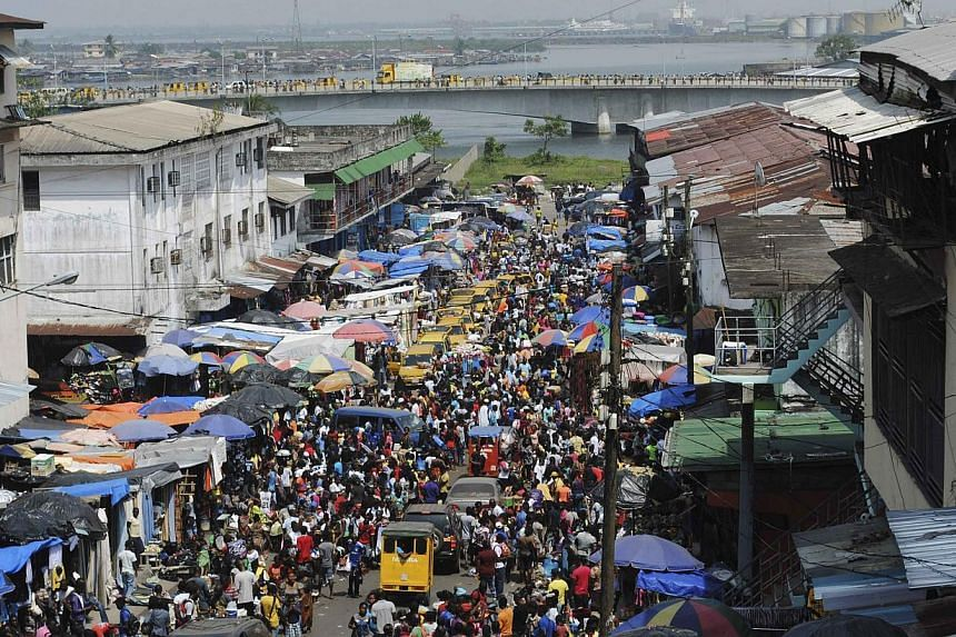A packed street in Monrovia on Dec 23, 2014. Ebola-ravaged Liberia on Wednesday lifted a night curfew in place since August to allow New Year's Eve services. -- PHOTO: REUTERS