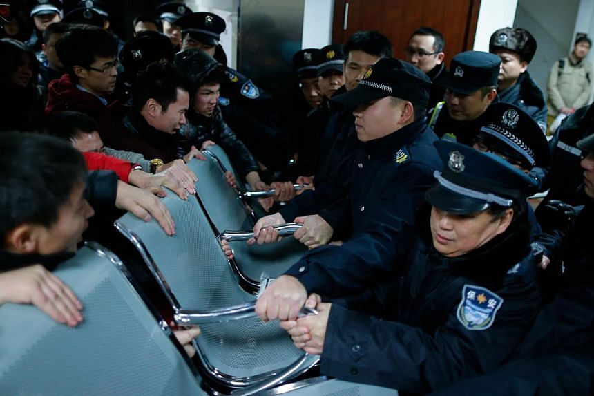 Angry family members clashing with security personnel in a hospital where some of the victims of a stampede by new year revellers were sent in Shanghai on Jan 1, 2015. -- PHOTO: AFP