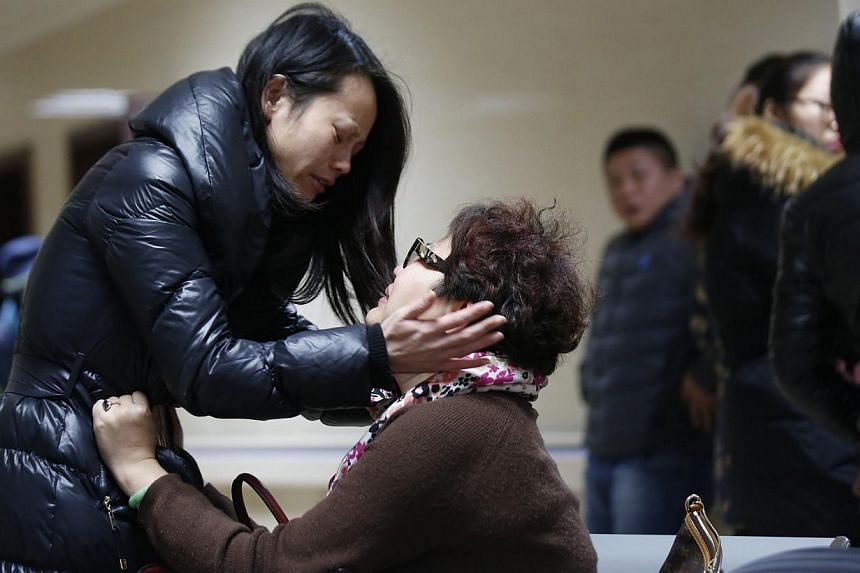 Relatives of a victim waiting at a hospital where injured people of a stampede incident were treated in Shanghai on Jan 1, 2015. -- PHOTO: REUTERS