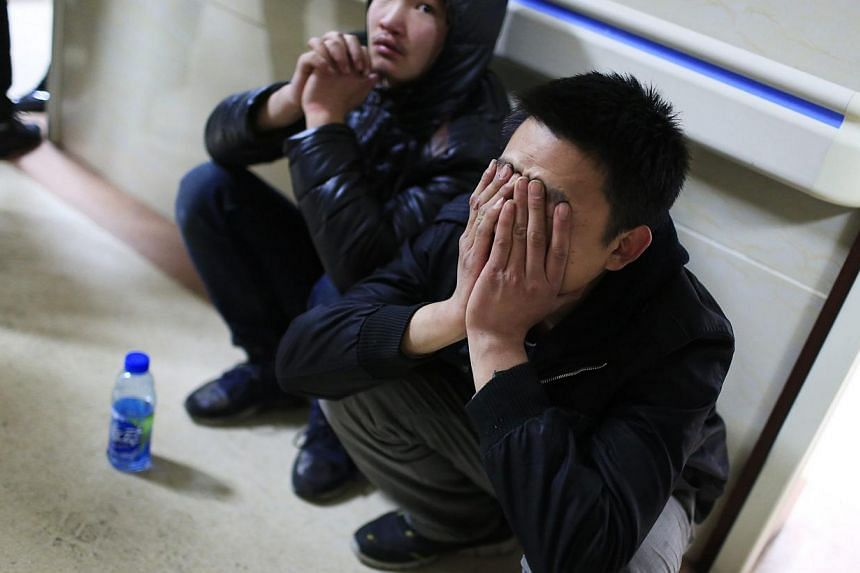 A friend of a victim waiting outside a hospital where injured people of a stampede incident were treated in Shanghai on Jan 1, 2015. -- PHOTO: REUTERS