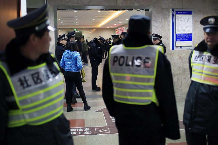Security personnel and policemen manning their posts at an entrance to the hospital where injured people of the stampede were treated in Shanghai on Jan 1, 2015. -- PHOTO: REUTERS