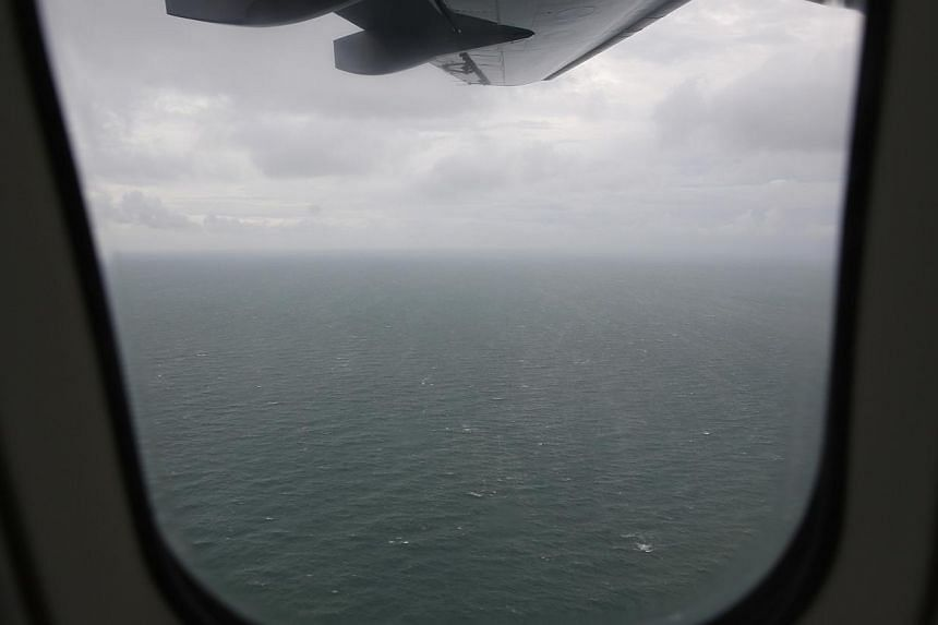 A view from an Indonesian Navy maritime surveillance plane on a mission to search for wreckage and the remains of passengers onboard the AirAsia QZ8501 flight, over the Karimata Strait south of Pangkalan Bun, Central Kalimantan on Jan 1, 2015. -- PHO