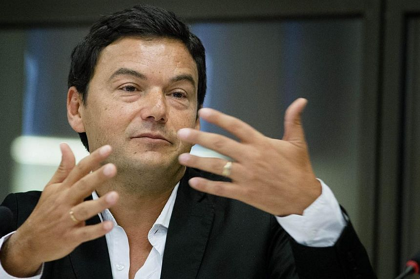 France's influential economist Thomas Piketty (above), author of Capital In The 21st Century, on Thursday refused to accept the country's highest award, the Legion d'honneur, to criticise the Socialist government in power. -- PHOTO: AFP