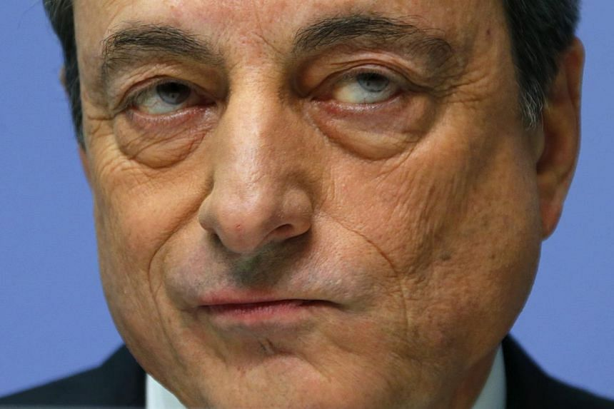 ECB president Mario Draghi addressing an ECB news conference on Dec 4, 2014. In an interview with a German paper, he warned that euro zone faces a growing risk of unstable prices. -- PHOTO: REUTERS