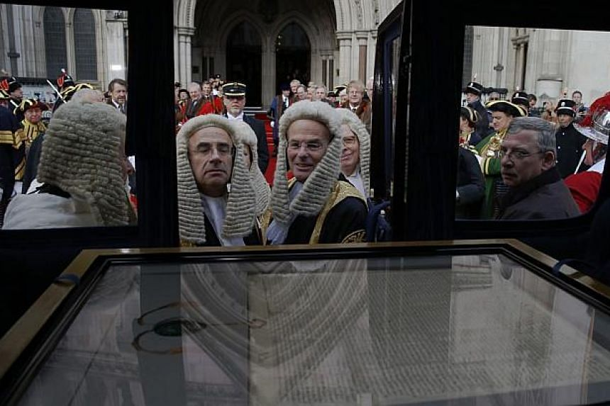Judges looking at the City of London's 1297 Magna Carta in a carriage during the Lord Mayor's show in London on Nov 8, 2014. English Heritage, the official government cultural agency, has listed the signing of the famous Magna Carta, or Great Ch