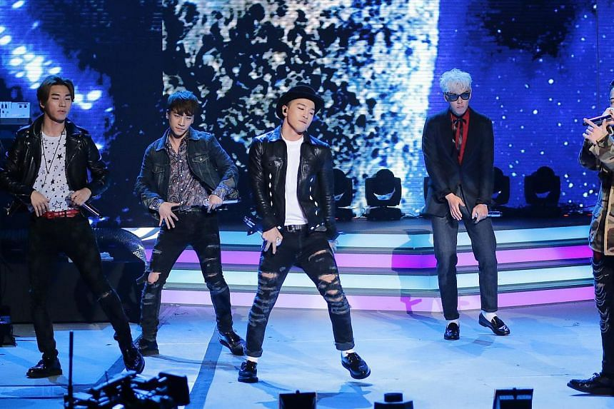 South Korean pop sensation BigBang (above) pumped up the crowd with an hour-long high energy set, while Singapore Mandopop singer Stefanie Sun belted out her top numbers. -- PHOTO: MEDIACORP