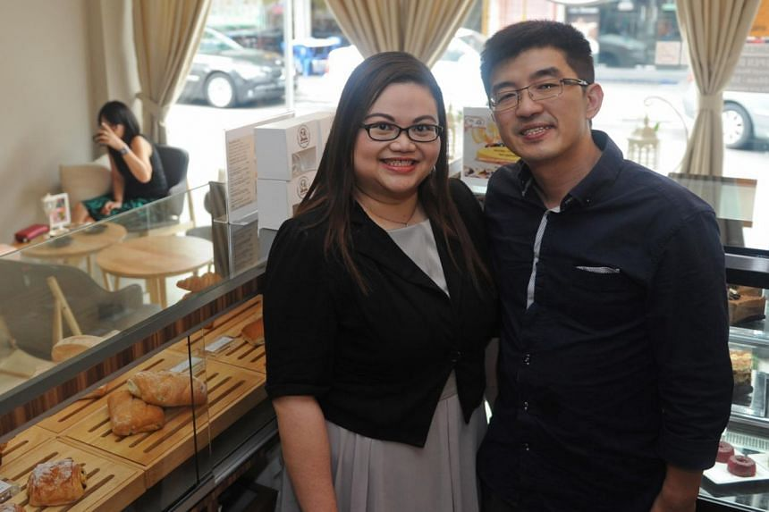 Ms Mary Leong and Mr Royce Ho, the husband-and-wife team behind RoyceMary Cafe, which is well-loved for its heart-shaped macarons and green tea lava cake. -- ST PHOTO: TIFFANY GOH