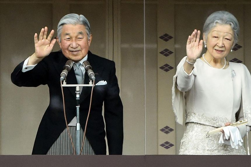 Japan's Emperor Akihito (left) and Empress Michiko (right) wave from the balcony of the Imperial Palace during their annual new year greeting in Tokyo on Jan 2, 2015.Japan's Emperor Akihito called for peace in his New Year's greeting to more th
