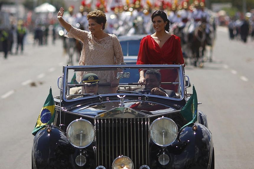 Brazil's President Dilma Rousseff (left) and daughter Paula riding towards Congress, where Ms Rousseff is to be sworn in for a second four-year term in Brasilia Jan 1, 2015. -- PHOTO: REUTERS