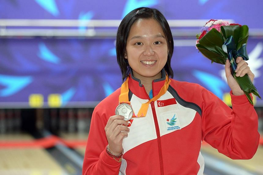 Bowler Jazreel Tan wins a silver medal in the 17th Asian Games Incheon 2014 women's singles bowling event held at the Anyang Hogye Gymnasium in Incheon, South Korea, on Sept 24, 2014. The Singaporen bowler has started 2015 on a roll by being cro