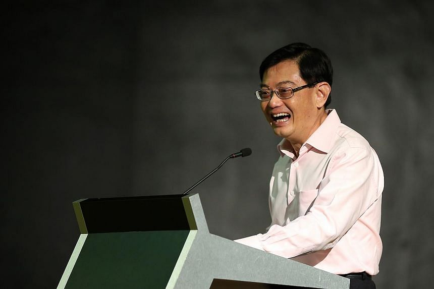 Minister for Education Heng Swee Keat speaks during his visit Yio Chu Kang Secondary on the first day of school of 2015 to kick-start the year-long SG50 activities and celebrations. -- ST PHOTO: NEO XIAOBIN