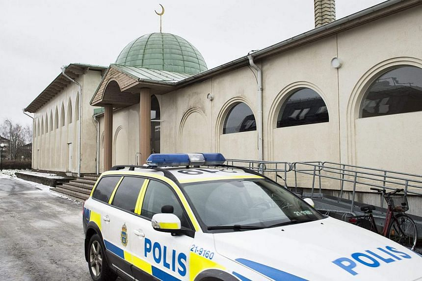A police car is parked in front of a mosque in Uppsala, Sweden, on Jan 1, 2015. A Molotov cocktail was thrown at the mosque early on Thursday. -- PHOTO: REUTERS