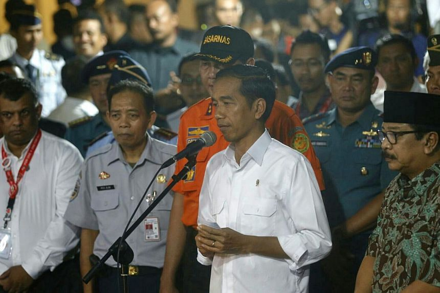 Indonesian president Joko Widodo speaks to the media after arriving at the crisis centre at Juanda International Airport Terminal 2 in Surabaya to meet with grieving family members on Dec 30, 2014. -- ST PHOTO: KEVIN LIM