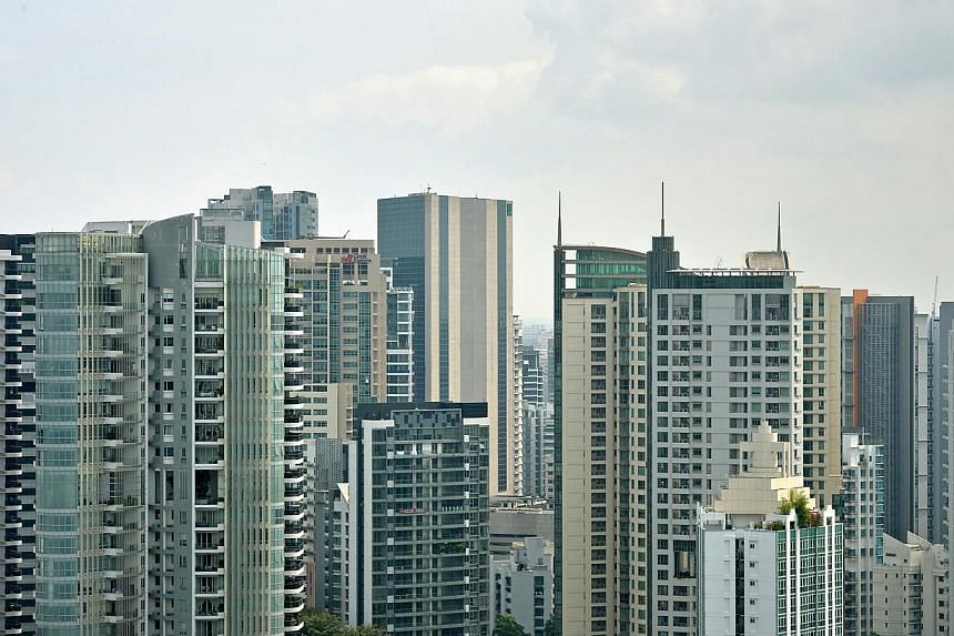 Experts reckon that the slowdown in private property prices in the last quarter of 2014 was characteristic, thanks to the year-end holiday period, ailing demand and curtailed home financing. -- PHOTO: ST FILE