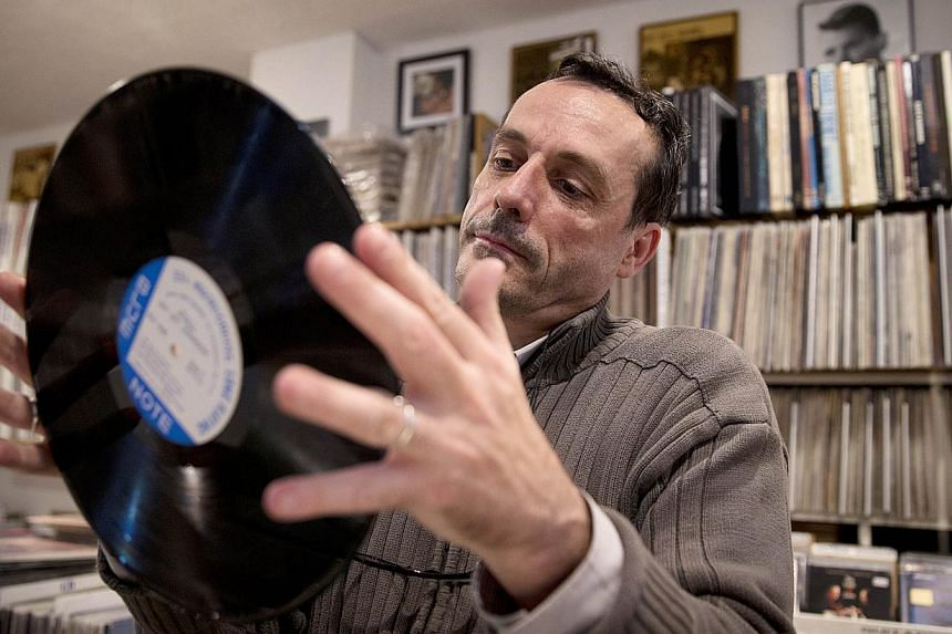 Vinyl sales and music streaming both soared by more than 50 per cent in 2014 in the United States, even as overall sales kept declining, a music industry monitor said. -- PHOTO: AFP
