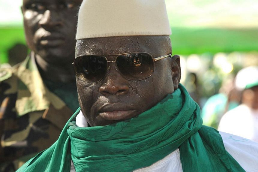 A file photo taken Nov 22, 2011 shows Gambian President Yahya Jammeh greeting supporters during a rally in Gambia.Dozens of military personnel and civilians have been arrested in The Gambia and a cache of explosives and weapons have been found