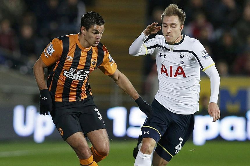 Hull City's Hatem Ben Arfa (left) challenges Tottenham Hotspur's Christian Eriksen during their English Premier League football match at the KC Stadium in Hull, northern England Nov 23, 2014. -- PHOTO: REUTERS