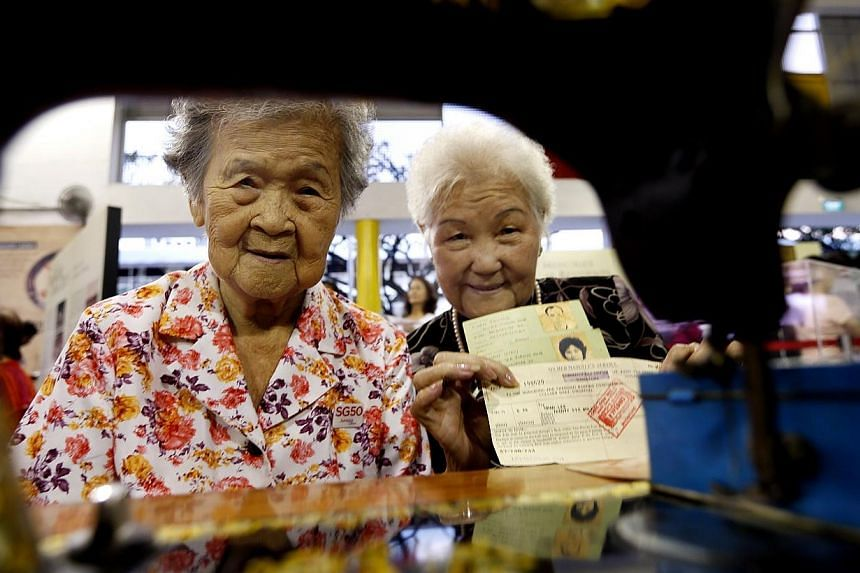 Walking Down Memory Lane 2015 at Jurong Green Community Club on Saturday, Jan 3, 2015. Mdm Kwoh Toh (left), 84, and Mdm Chan Kieu (right), 74 are seen attending theexhibition on the transformation of the Jurong estate during 1970s. The objectiv