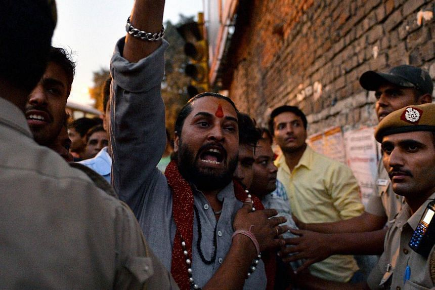 A drummer wearing a Modi mask as BJP supporters celebrated the party's victory in the Jharkhand state assembly polls last month. The BJP also broke a critical psychological and political barrier in Jammu and Kashmir, nearly doubling its vote share. B