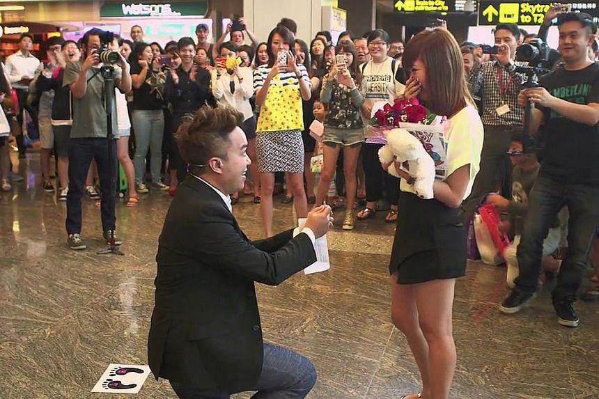 To cheers and encouragement from the crowd at Changi Airport, Mr John Khoo went down on bended knee and proposed to Ms Mellissa Chan on Dec 11. The 10-minute video, posted on YouTube and Stomp, has attracted much online attention.