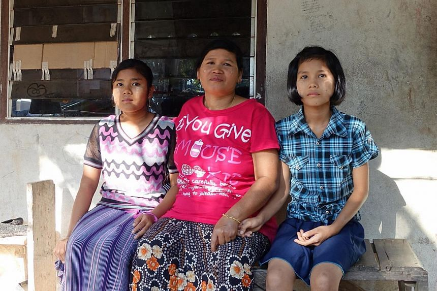 Myanmar national Than Than Htay, 47, has been working as a textile worker in Poipet for five years. Her two daughters - Nay Yee Oo, 15 and Shoon Le Yee, 12 - are forbidden from venturing out of the school and factory dormitory premises as they do not