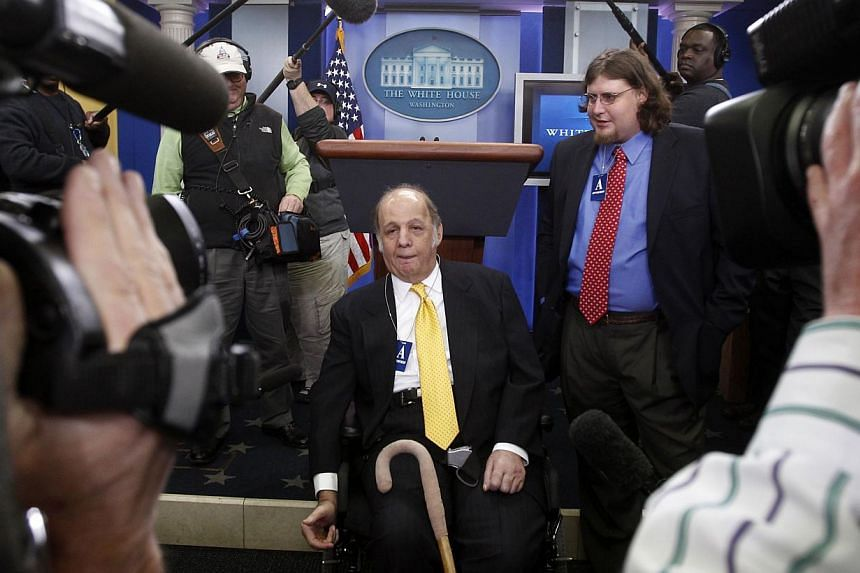 Former White House press secretary James Brady in a March 2011 picture showing him and his son, Scott (right), during a visit to the White House Press Briefing Room in Washington. Would-be presidential assassin John Hinckley Jr will not face criminal