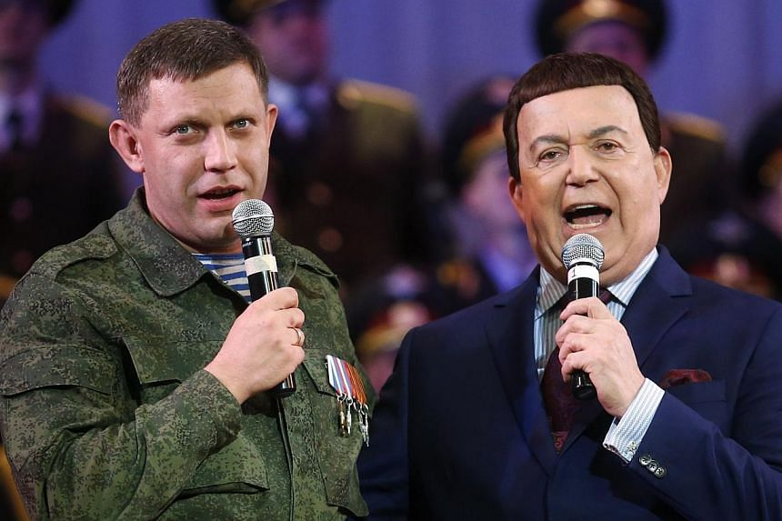 Russian singer Iosif Kobzon performing with Mr Alexander Zakharchenko, separatist leader of the self-proclaimed Donetsk People's Republic,at a local theatre in Donetsk, eastern Ukraine, on Oct 27, 2014. TV network Inter's biggest sin in t