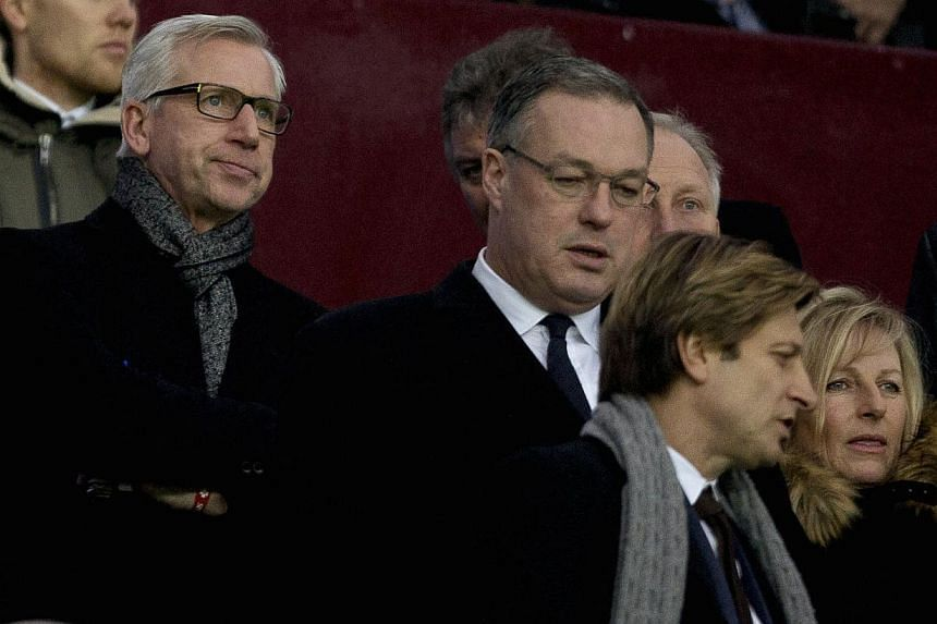 Crystal Palace manager Alan Pardew (left) arrives in the stands with Crystal Palace chairman Steve Parish (second right) to watch the team's English Premier League soccer match against Aston Villa on Jan 1, 2015. Pardew is expected to take his first