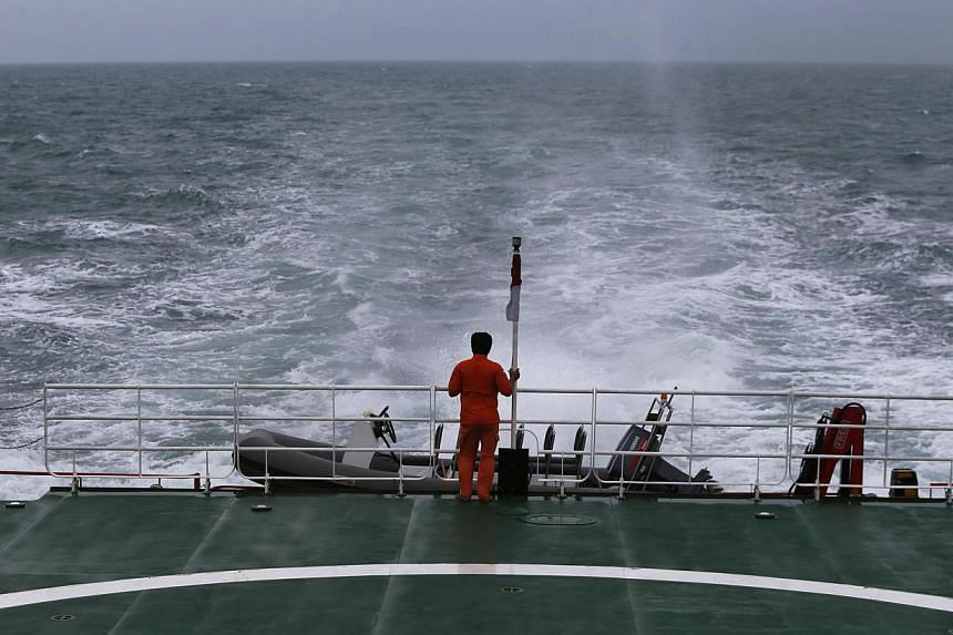 The SAR ship KN Purworejo on a search operation for passengers onboard AirAsia flight QZ8501 in the Java Sea on Jan 3, 2015. -- PHOTO: REUTERS
