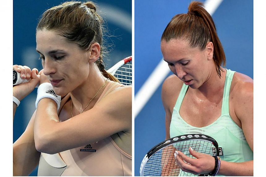 World No. 5 Andrea Petkovic of Germany (left) and sixth-seeded Jelena Jankovic of Serbia both crashed out of the season-opening Brisbane International tennis tournament on Sunday, Jan 4, 2015. -- PHOTO: AFP