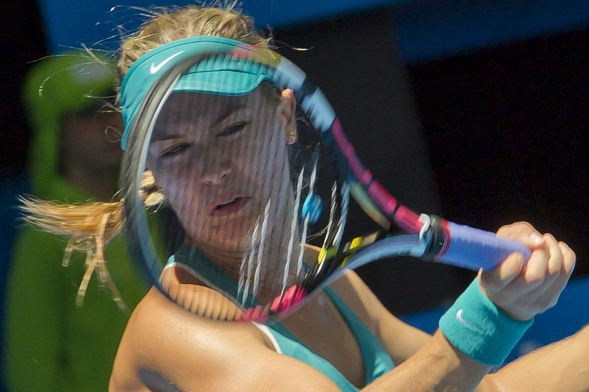 Eugenie Bouchard of Canada hits a return against Lucie Safarova of the Czech Republic during their first session women's singles match on day one of the Hopman Cup tennis tournament in Perth on Jan 4, 2015. -- PHOTO: AFP