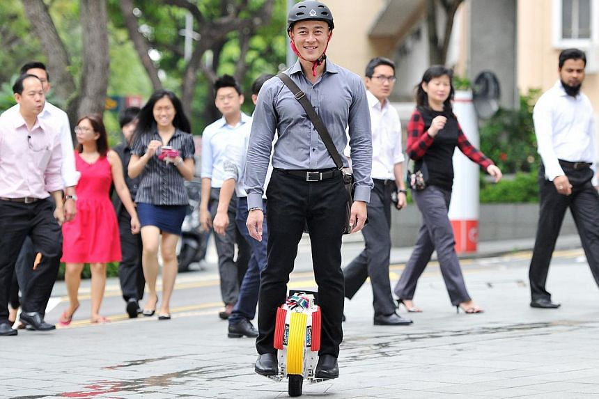 Mr Rick Tan, 43, takes 20 minutes to ride his electric unicycle from his home in Boon Keng to his office in Beach Road. -- PHOTO: LIM YAOHUI FOR THE SUNDAY TIMES