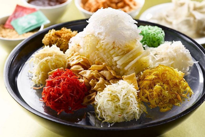 Summer Palace's Nutritious Bird's Nest And Pear Yusheng (above) and Si Chuan Dou Hua's Prosperity Suckling Pig stuffed with glutinous rice. -- PHOTO: THE REGENT SINGAPORE